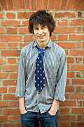 Model released teenage boy portrait casually dressed wearing shirt and tie, UK