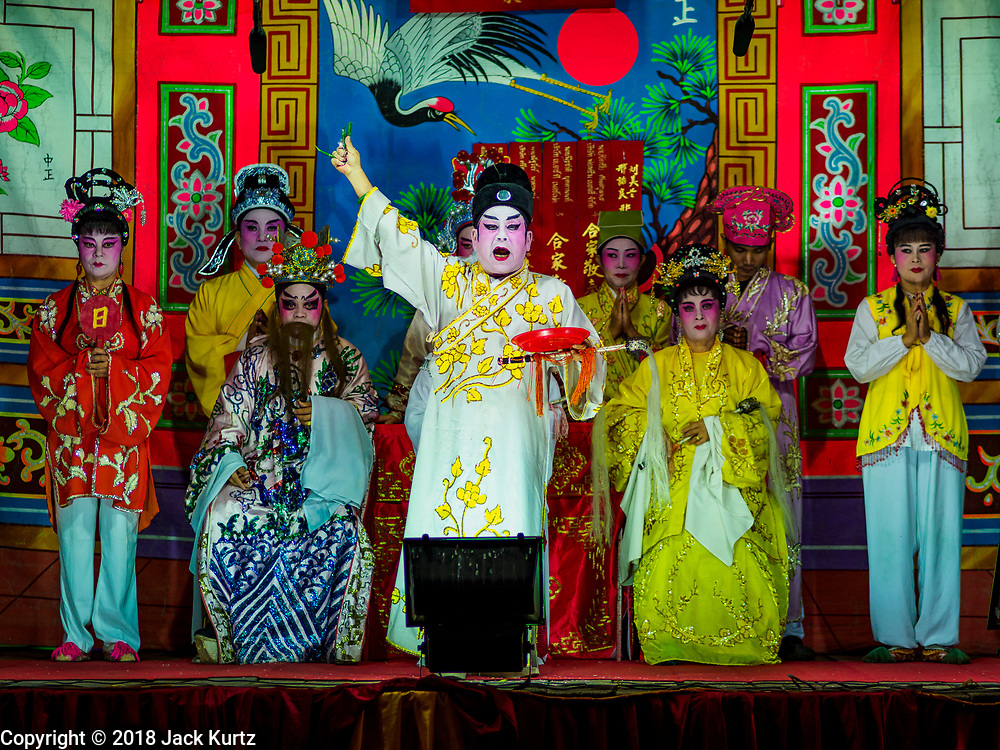 """12 JANUARY 2018 - BANGKOK, THAILAND:      A Chinese opera performance for the Lunar New Year at the Chaomae Thapthim Shrine in the Dusit district of Bangkok. Many Chinese shrines and temples host Chinese operas during the Lunar New Year. Lunar New Year is 16 February this year and opera troupes are starting their holiday engagements at local Chinese temples and shrines. The new year will be the """"Year of the Dog."""" Chinese New Year, also called Lunar New Year or Tet, is widely celebrated in Chinese communities around the world. Thailand has a large Chinese community and Lunar New Year is an important holiday.    PHOTO BY JACK KURTZ"""