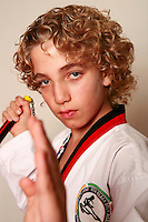 7 February 2008: 11 year old boy Ethan Stafford with numbchuck weapon. Tae Kwon Do student athletes in motion. Young kids practicing Taekwondo at the USA Black Belt Academy in Huntington  Beach, CA. Tae Kwon Do is a Korean Martial Art discipline that trains the body and mind.  It is global sport that is an official Olympic sport. ? Background Retouched *