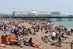 © Licensed to London News Pictures. 30/07/2014. Brighton, UK. people relaxing and sunbathing during lunch on Brighton beach.  temperatures are expected to reach around the 24C in Brighton and the South Coast. Photo credit : Hugo Michiels/LNP