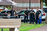 Wilkes-Barre, PA (July 11, 2020) -- Unmasked Wilkes-Barre police officers congregate near a canopy on Public Square during the Black Lives Matter NEPA United Movement event.