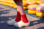 Dutch clogs traditional shoes and socks worn by woman Kaasmeisje, Alkmaar cheese market, The Netherlands