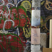 Installed reproductions of war zone graffiti taken by Louie Palu in Afghanistan being hung in alleys in Toronto, Canada with local graffiti art for the 2009 Contact Photography Festival.