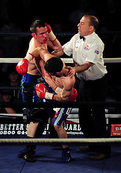 The referee intervenes  - Photo mandatory by-line: Dougie Allward/JMP - Tel: Mobile: 07966 386802 27/04/2013 - SPORT - FOOTBALL - City Academy Sports Centre - Bristol - Lee Haskins V Martin Ward - British bantamweight title