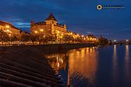 Bellevue Building reflects in the Vltava River at dawn in Prague, Czech Republic