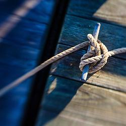 Rope tied to a dock in Pamet Harbor in Truro, Massachusetts. Cape Cod.