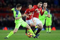 15 January 2017 - Premier League - Manchester United v Liverpool - Wayne Rooney of Manchester United rakes his studs down the shin of James Milner of Liverpool - Photo: Marc Atkins / Offside.