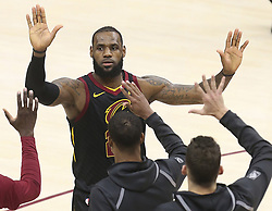 April 29, 2018 - Cleveland, OH, USA - Cleveland Cavaliers' LeBron James slaps hands with teammates during a late fourth quarter time out against the Indiana Pacers during Game 7 of the Eastern Conference First Round series on Sunday, April 29, 2018 at Quicken Loans Arena in Cleveland, Ohio. The Cavs won the game, 105-101. (Credit Image: © Phil Masturzo/TNS via ZUMA Wire)