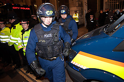 © licensed to London News Pictures. London, UK. 27/01/12. Riot police prepare to enter. Protestors cleared from new site in the City of London. The 'Bank of Ideas' group, who had occupied the disused Bank of Iraq building at 7-10 Leadenhall, are cleared after it emerged the building is a diplomatic premises under Section 9 of the 1977 Criminal Law Act. Fire services cleared the street after finding a strong smell of Diesel upon entry to the premises and cleared. Photo credit: Jules Mattsson/LNP