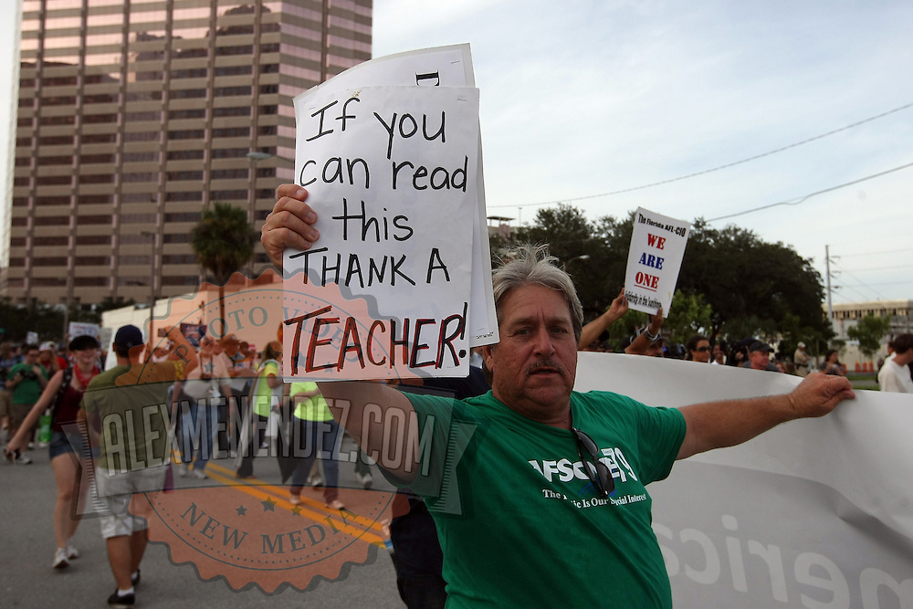 A teacher as seen in a protest parade during the Republican National Convention in Tampa, Fla. on Wednesday, August 29, 2012. (AP Photo/Alex Menendez)
