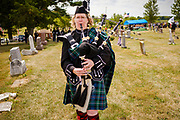 29 AUGUST 2020 - RUNNELLS, IOWA: DAWN BALDWIN plays the bagpipes at the funeral for Pvt. Roy Brown Jr. in Runnells, IA. Pvt. Brown was a US Army soldier in World War II. He was an infantryman in the 126th Infantry Regiment, 32nd Infantry Division, serving in the Australian Territory of Papua (now Papua New Guinea). He went missing in action on Dec. 2, 1942. Unidentified remains were recovered on Feb. 2, 1943 and were eventually interred in the Manila American Cemetery. On May 14, 2019, Defense POW/MIA Accounting Agency using dental records, circumstantial evidence and DNA identified the remains as Pvt. Brown's. He was reinterred in the Lowman Cemetery in Runnells Saturday.     PHOTO BY JACK KURTZ
