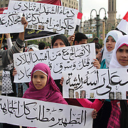 A family comes together in Cairo's Tahrir Square to call for justice for those in ex-president Mubarak's regime who committed abuses.