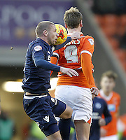 Blackpool's Steven Davies junmps with Millwall's Alan Dunne<br /> <br /> Photographer Mick Walker/CameraSport<br /> <br /> Football - The Football League Sky Bet Championship - Blackpool v Millwall - Saturday 10th January 2015 - Bloomfield Road - Blackpool <br /> <br /> © CameraSport - 43 Linden Ave. Countesthorpe. Leicester. England. LE8 5PG - Tel: +44 (0) 116 277 4147 - admin@camerasport.com - www.camerasport.com