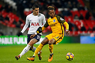Gaetan Bong of Brighton & Hove Albion (R) battles with Erik Lamela of Tottenham Hotspur (L). Premier league match, Tottenham Hotspur v Brighton & Hove Albion at Wembley Stadium in London on Wednesday 13th December 2017.<br /> pic by Steffan Bowen, Andrew Orchard sports photography.