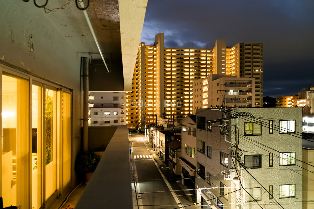 residential neighborhood with large flat building at night in Yokosuka Japan