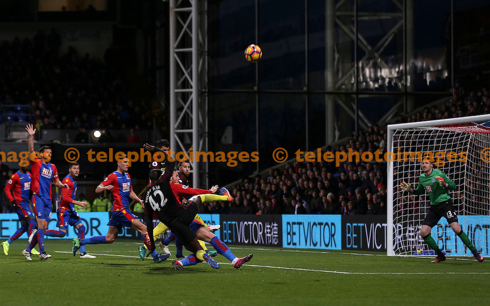 Yaya Toure has a shot on target during the Premier League match between Crystal Palace and Manchester City at Selhurst Park in London. Novemeber 19, 2016.<br /> Jack Beard / Telephoto Images<br /> +44 7967 642437
