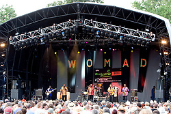 Orchestra Baobab perform on the Main Stage during the Womad Festival in Charlton Park, Wiltshire.