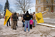"02 JANUARY 2021 - DES MOINES, IOWA: Men with Gadsen Flags at the Iowa State Capitol. About 30 people marched around the Iowa State Capitol Saturday afternoon to protest the outcome of the November 3 general election in the United States. They are a part of the ""Stop the Steal"" movement which maintains that the election was stolen from Donald Trump by massive voter fraud. There is no evidence supporting their conspiracy theory. This is the 9th week Donald Trump supporters have marched around the Capitol. They've been there every week since the Nov. 3 election. More than 1,000 people showed up the first week, but the crowd has gotten smaller every week.      PHOTO BY JACK KURTZ"
