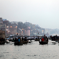 Asia, India, Varanasi.  Early morning boats on the Ganges River.