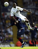 Photo Aidan Ellis.<br /> Leeds United v Portsmouth.<br /> FA Barclaycard Premiership.<br /> 25/04/2004.<br /> Leeds Lucas Radebe and Pompey's Aiyegbeni Yakubu