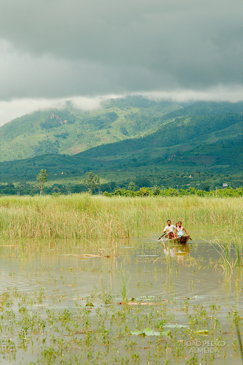 Marn working at a lake nearby Nyaungshwe