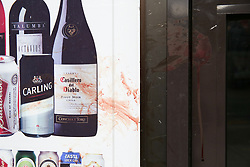 © Licensed to London News Pictures. 25/04/2019. London, UK. Blood stains Hill's New Point newsagent's window on Leytonstone High Road, Waltham Forest in East London. Two men were stabbed multiple times at a bus stop next to Hill's New Point newsagent close to Leytonstone High Road overground station just before 8pm on Wednesday 24 April 2019. A man in his 20s remains in a hospital in a critical condition. Photo credit: Dinendra Haria/LNP