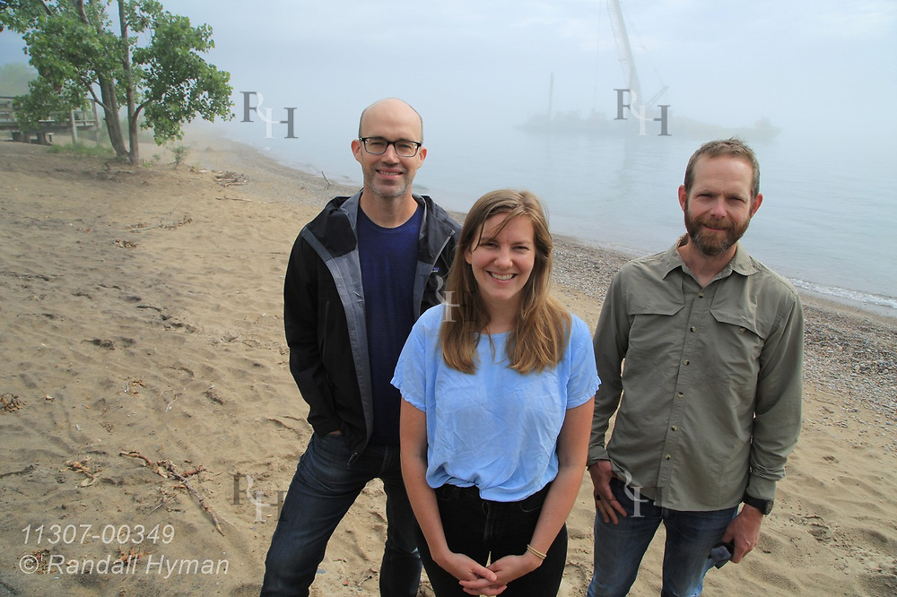 Healthy Ports landscape architecture profs Brian Davis (UVirginia) and Sean Burkholder (UPenn) pose with UPenn Lecturer Theresa Ruswick at Illinois Beach State Park as Army Corps team constructs underwater rubble ridge along shore; Zion, Illinois.