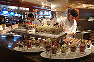 A pastry chef prepares desserts at a Seasons 52 restaurant in Orlando, Florida.  Seasons 52 is a restaurant chain owned by Darden Restaurants.
