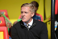 Garry Monk, manager of Swansea City looks on from the dugout before k/o. Barclays Premier League, Watford v Swansea city at Vicarage Road in London on Saturday 12th September 2015.<br /> pic by John Patrick Fletcher, Andrew Orchard sports photography.
