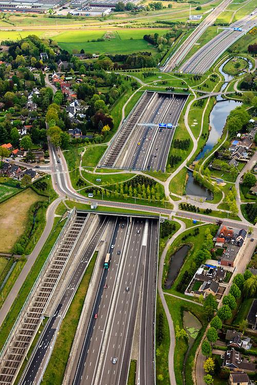 Nederland, Noord-Brabant, Breda, 09-05-2013; infrabundel, combinatie van autosnelweg A16 gebundeld met de spoorlijn van de HSL (re). Stadsduct Valbos in de voorgrond, gezien naar Stadsduct Overbos.<br /> De bundel loopt in tunnelbakken, lokale wegen gaan over deze infrabundel heen, door middel van de zogenaamde stadsducten, gedeeltelijk ingericht als stadspark. <br /> Combination of motorway A16 and the HST railroad, crossed by  local roads by means of *urban ducts*, partly designed as public  parks .<br /> luchtfoto (toeslag op standard tarieven);<br /> aerial photo (additional fee required);<br /> copyright foto/photo Siebe Swart.
