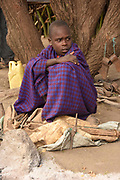 Young boy, embers of the Datoga tribe sitting. Photographed in Lake Eyasi Tanzania