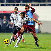 Besiktas's Simao SABROSA (L) and Trabzonspor's Remzi Giray KACAR (R) during their Turkey Cup Group B matchday 5 soccer match Besiktas between Trabzonspor at the Inonu stadium in Istanbul Turkey on Wednesday 26 January 2011. Photo by TURKPIX