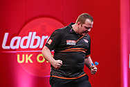 Dirk van Duijvenbode wins his fourth round match against Gary Anderson and celebrates during the Ladbrokes UK Open at Stadium:MK, Milton Keynes, England. UK on 5 March 2021.
