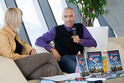 Editor Branka Fiser of Ucila with Marko Baloh, Slovenian ultra-cycling rider during press conference when he published his first book Nedokoncana zgodba by Ucila publisher on October 9, 2012 in Kristalna palaca, Ljubljana, Slovenia. (Photo By Vid Ponikvar / Sportida)