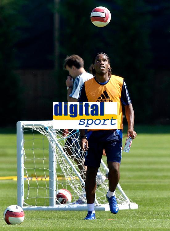 Photo: Daniel Hambury.<br />Chelsea Training Session. The Barclays Premiership. 24/07/2006.<br />Didier Drogba plays the ball during training.