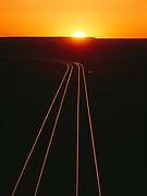 Sunrise over the Burlington Northern Santa Fe Railroad tracks crossing Petrified Forest National Park, Arizona.