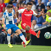 BARCELONA, SPAIN - August 18:  Jules Kounde #12 of Sevilla challenged by Victor Campuzano #31 of Espanyol during the Espanyol V  Sevilla FC, La Liga regular season match at RCDE Stadium on August 18th 2019 in Barcelona, Spain. (Photo by Tim Clayton/Corbis via Getty Images)