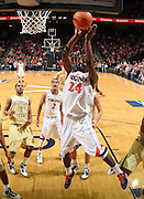 Jan. 22, 2011; Charlottesville, VA, USA; Virginia Cavaliers guard K.T. Harrell (24) shoots the ball in front of Georgia Tech Yellow Jackets guard Maurice Miller (3) during the game at the John Paul Jones Arena. Virginia won 72-64. Mandatory Credit: Andrew Shurtleff-US PRESSWIRE