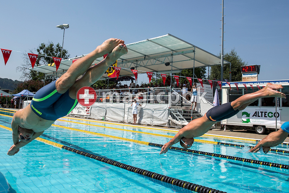 (L-R) Winner Andrey GRECHIN of Russia and 3rd placed Vladimir POPOV of Russia compete in the men's 100m Freestyle Final during the Swiss Swimming Summer Championships held at the 50m outdoor pool Wislepark in Worb, Switzerland, Saturday, July 4, 2015. (Photo by Patrick B. Kraemer / MAGICPBK)