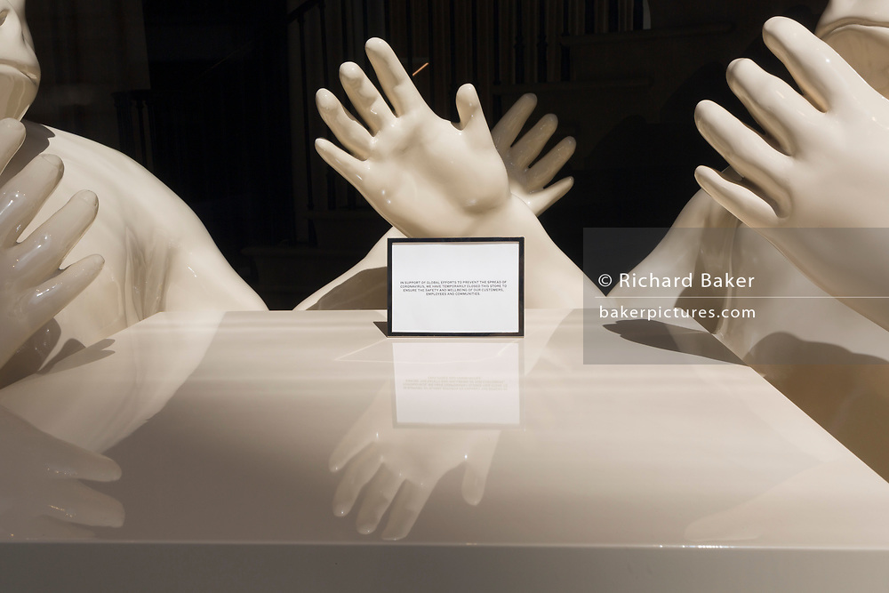 During the UK's Coronavirus pandemic lockdown and on the day when a further 255 deaths occurred, bringing the official covid deaths to 37,048, <br /> it is expected that many shops and retail businesses will open again on 15th June. In the window of the Regent Street branch of Burberry is a display of gorillas and a notice dating to when lockdown commenced, telling customers of the shops's temporary closure, on 26th May 2020, in London, England.