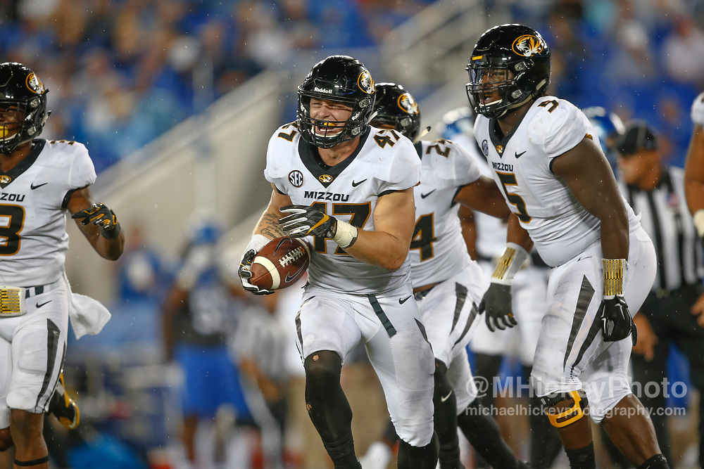 LEXINGTON, KY - OCTOBER 07: Cale Garrett #47 of the Missouri Tigers celebrates a fumble recovery during the game against the Kentucky Wildcats at Commonwealth Stadium on October 7, 2017 in Lexington, Kentucky. (Photo by Michael Hickey/Getty Images) *** Local Caption *** Cale Garrett