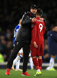 Liverpool manager Jurgen Klopp (left) consoles Roberto Firmino after the final whistle during the Premier League match at Goodison Park, Liverpool.
