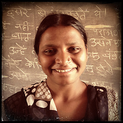 """iPhone portrait of Surya Kumari, approximate age 16, in a village outside of Banswara, Rajasthan, India, April 5, 2013. """"If I would get married at a young age then I would get a little weak, I would get a little thin. My brain would become weak. I said no to marriage, then my family refused too. They said, 'This girl will study,'"""" said Kumari. <br /> <br /> Under Indian law, children younger than 18 cannot marry. Yet in a number of India's states, at least half of all girls are married before they turn 18, according to statistics gathered in 2012 by the United Nations Population Fund (UNFPA). However, young girls in the Indian state of Rajasthan—and even a few boys—are getting some help in combatting child marriage. In villages throughout Tonk, Jaipur and Banswara districts, the Center for Unfolding Learning Potential, or CULP, uses its Pehchan Project to reach out to girls, generally between the ages of 9 and 14, who either left school early or never went at all. The education and confidence-building CULP offers have empowered young people to refuse forced marriages in favor of continuing their studies, and the nongovernmental organization has provided them with resources and advocates in their fight."""
