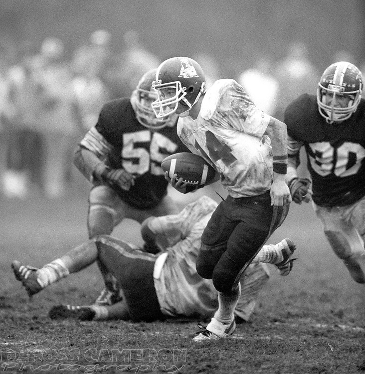 Unidentified Lenape Valley quarterback (14) scrambles away from Jefferson defensive pressure during a high school football game, Saturday, Nov. 8, 1986, in Jefferson, N.J. (D. Ross Cameron/North Jersey Advance)