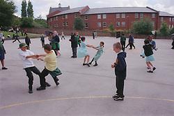 Primary school children playing in school playground,