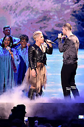 Pink and Dan Smith from Bastille on stage at the Brit Awards 2019 at the O2 Arena, London. Photo credit should read: Matt Crossick/EMPICS Entertainment. EDITORIAL USE ONLY