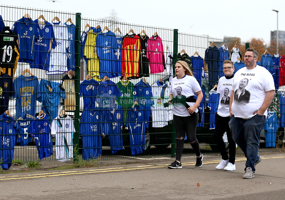 Fans look at shirts for sale outside the ground