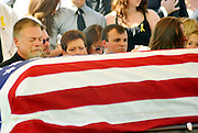 Vincent Thompson, left, grieves during a Committal Service with full military honors for his son, Army Spc. Blair D. Thompson at Fort Stanwix National Park in Rome, NY, Sunday, July 4, 2010.  Thompson, 19, was killed while serving in Afghanistan on June 25, 2010.<br /> (AP Photo/Heather Ainsworth)