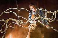 Terry Chamber works to afix adhesive to the back of a metal art installation at the Jackson Hole Airport. Chambers and his custom iron design team created the aerial rendering of the Snake River for the Jackson Hole Airport during the last several months.