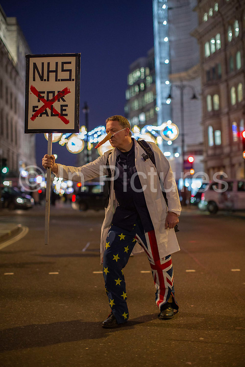 A man holding a NHS Not For Sale placard during the Stop Trump Coalition and CND protest against U.S. President Donald Trump UK visit to attend the NATO North Atlantic Treaty Organisation summit on the 3rd December 2019 in London in the United Kingdom. Ahead of a British national election on 12th December 2019, Stop Trump Coalition and CND, Campaign for Nuclear Disarmament organised a protest to target a banquet at Buckingham Palace where Trump will dine with the Queen and other NATO leaders. The U.K. is hosting NATO summit to mark the military alliances 70th anniversary.